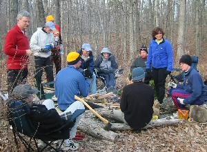 Group around the camp fire after running the first section of the MMT course