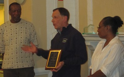 Bob Gaylord receives James Moore award from James and Rebecca Moore